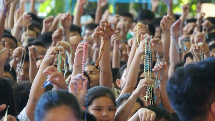 Children pray the rosary in the Philippines during the One Million Children Praying the Rosary campaign
