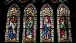 Stained glass windows portraying 4 saints