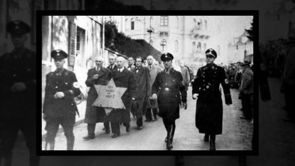 Jews_forced_to_march_with_star_Kristallnacht_ok.jpg