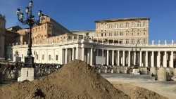 Sand sits in St. Peter's Square, waiting for the sculptor's hand