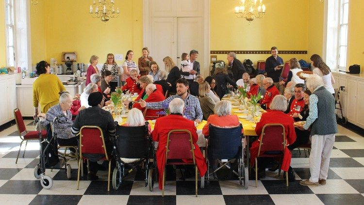 A group of members of the Sovereign Order of Malta organize a tea-party for the elderly to mark the World Day of the Poor