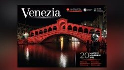 The Rialto Bridge of Venice lit up in red.