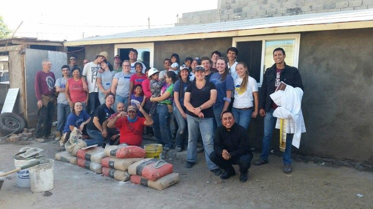 Fr Jesse Esqueda (kneeling, right) with a group at the Oblate Mission of La Morita, near Tijuana, Mexico (photo: Oblate Youth Mission)