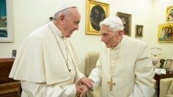 Pope Francis greets Pope emeritus Benedict XVI (file photo)