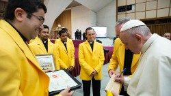 Pope Francis autografing a bat for the cricket club in his hometown, Buenos Aires, Argentina.