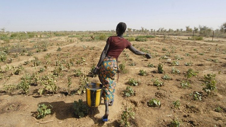 A woman farming in a drought-stricken area of Mali