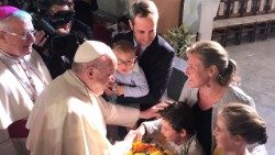 Pope Francis greets a family at St. Joseph's Cathedral in Abu Dhabi