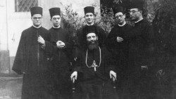Bishop Giovani Mele (C), first bishop of Lungro, with several priests