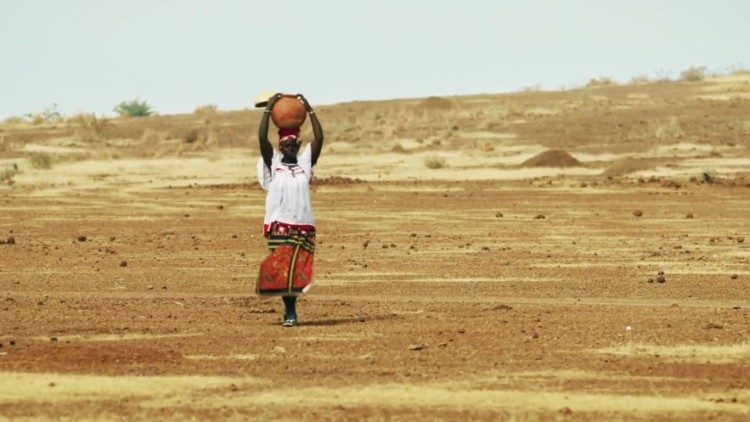 A woman in Burkina Faso carries water