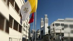 Vatican and Moroccan flags fly near the Cathedral in Rabat
