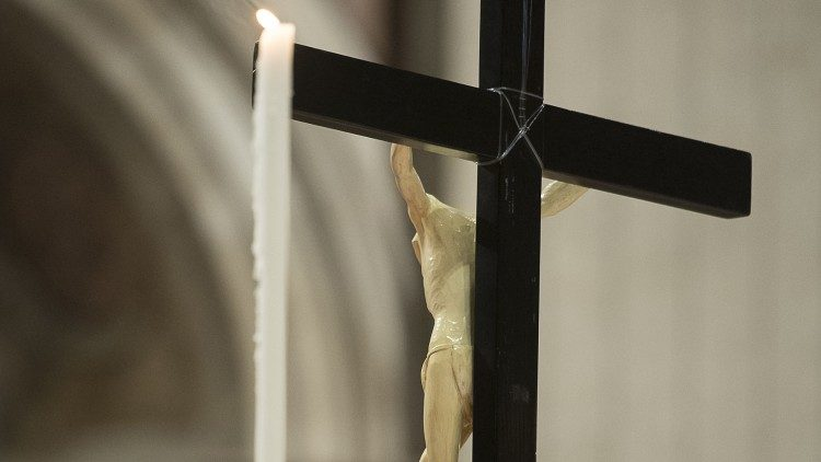 A crucifix and a candle