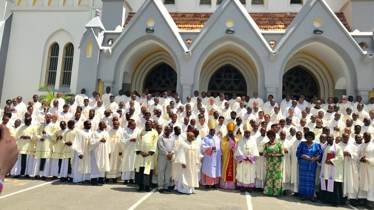 Cardinal Pengo with priests of the Archdiocese of Dar-es-Salaam pose for a photo in front of the Cathedral