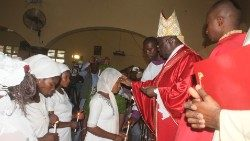 Bishop Matthew Hassan Kukah, Bishop of Sokoto, administors the Sacrament of Confirmation in his diocese.