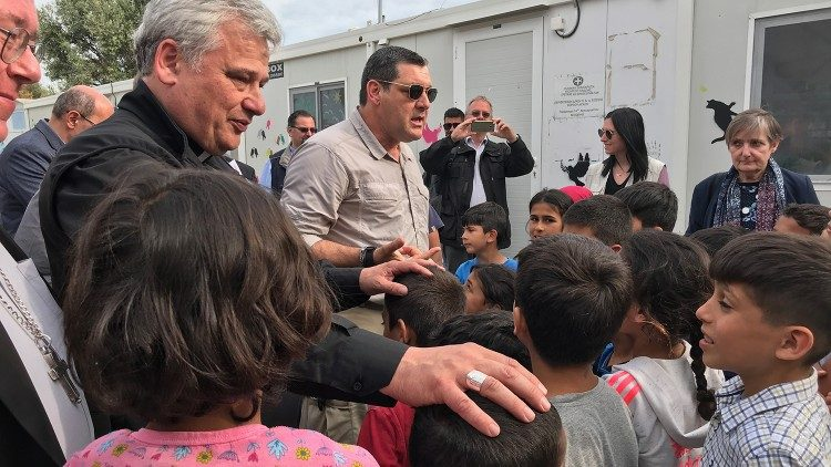Cardinal Krajewski with migrants in Lesbos