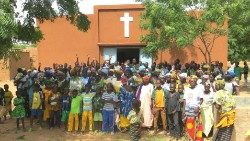 A Catholic Church and some of the faithful in Burkina Faso