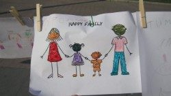"A child's drawing titled ""Happy family"""