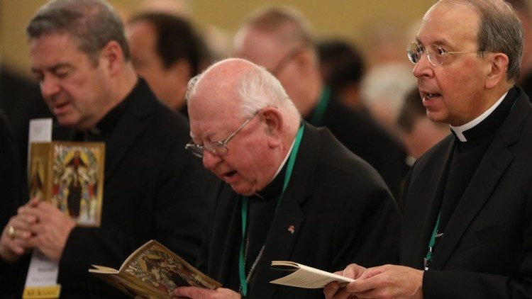Bishops praying during the Spring General Assembly of the USCCB  (photo courtesy of Bob Roller/CNS)