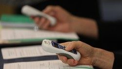 Bishops use electronic voting devices during the spring General Assembly of the USCCB (CNS photo/Bob Roller)