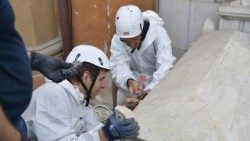 Forensic experts working on one of the tombs in the Vatican's Teutonic Cemetery