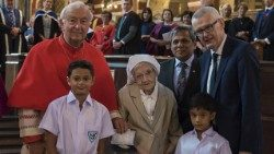 Sr Berchmans with Cardinal Nichols, Muhammad Nafees Zakaria (center R), Adrian O'Neill (R), and two former pupils