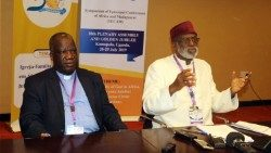 Malawian Archbishop of Blantyre, Luke Msusa (l) with Ghana's Cape Coast Archbishop Gabriel Charles Palmer-Buckle at SECAM in Uganda