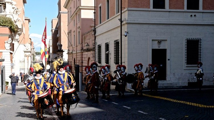 Members of the Swiss Guard marching next to their barracks in the Vatican in 2019.