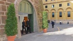 Two clients exit the Vatican Bank