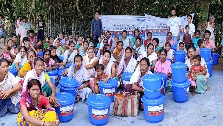 Caritas distributing relief material to flood affected people in India's Assam state.