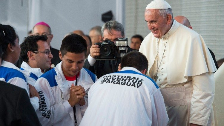 File photo of Pope Francis greeting young Paraguayans in Asuncion on 12 July 2015