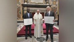 Jesuit priest Father Paul Béré  (L) and Professor Charles Margrave Taylor, (R)  together with Pope Francis.