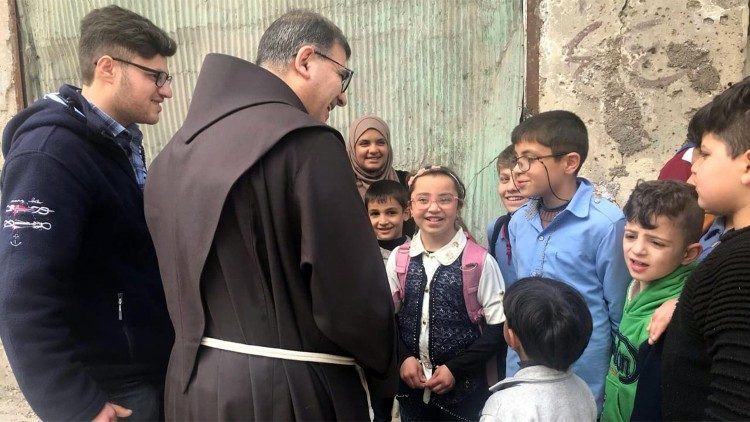 Fr Firas Lufti and children of the Therapeutic Art project