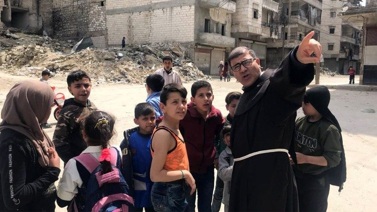Father Firas Lufti with the children of Aleppo