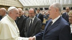 Prof. Giuseppe Dalla Torre shakes hands with Pope Francis on 17 December 2019