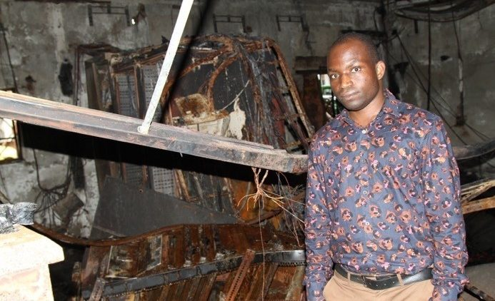Fr. Jailos Mpina of Luntha TV at the scene of a fire that damaged Malawi Telecommunications Limited's broadband hub in Lilongwe