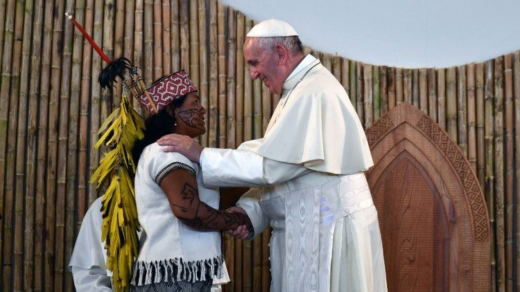 Pope Francis greets an indigenous woman in Puerto Maldonado, Peru