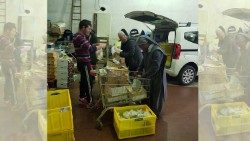 Nuns and volunteers prepare food to distribute to the poor