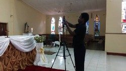 Joseph Phiri, a youth at St Theresa's Cathedral, Livingstone, Zambia setting up for live streaming of the Eucharist