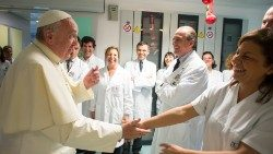 Pope Francis visits healthworkers at Bambino Gesù pediatric hospital in Rome on International Nurses Day in 2013