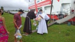 "Bishop Bernardo Bahlmann distributes medical equipment brought on the Amazon River by the ""Pope Francis"" Hospital Ship and its crew"