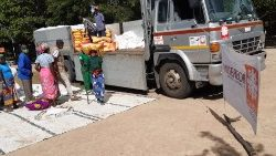 (File) Caritas Mozambique distributing food