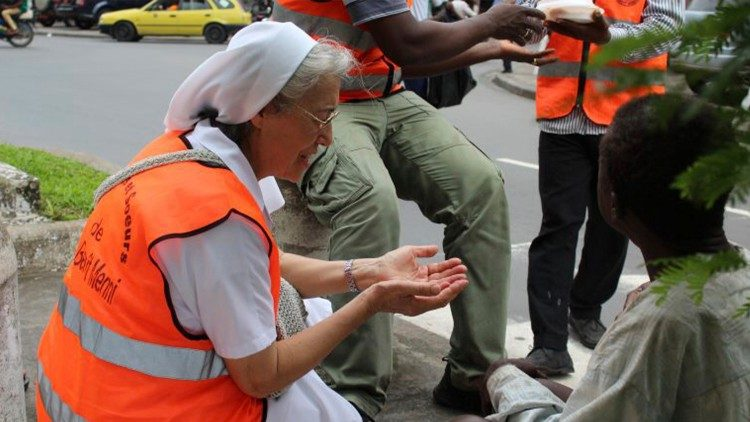 A nun working with the poor