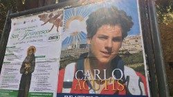 Poster promoting Carlo Acutis' beatification in Assisi appears side by side with program for celebrations for the Feast of St Francis