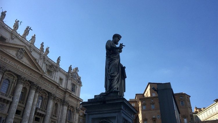 A statue of St. Peter in front of the Vatican Basilica