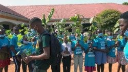 South Sudan children with fruit tree seedlings given to them by Bishop Kussala
