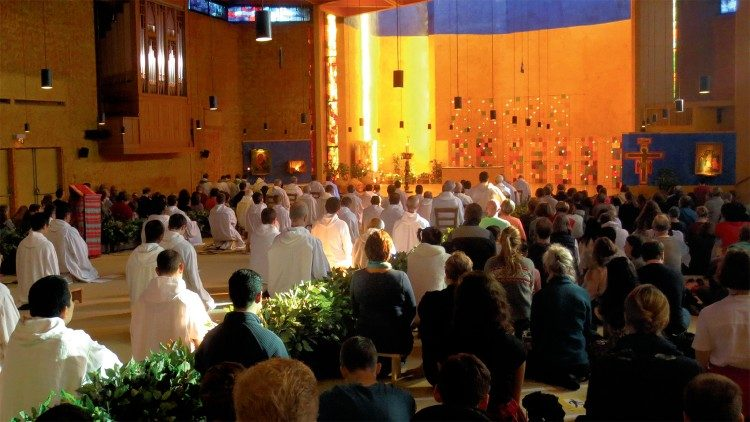File photo: young people pray at the Taizé Community before the pandemic