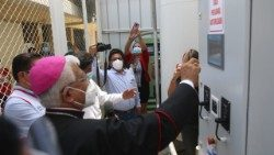"Archbishop Miguel Cabrejos blesses an oxygen-bottling machine as part of ""Breathe, Peru"""