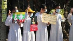 Catholic priests joining Myanmar 's proests against the military coup,  demanding the restoration of their elected government and leaders.