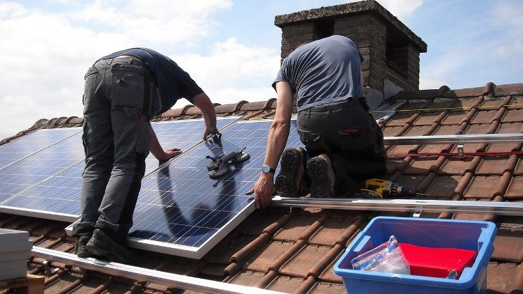 Installation of solar panels on a roof.