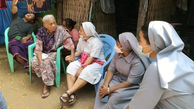 23 February, Sisters comforting the grandmother of the 16-year-old boy killed in the protests on Saturday