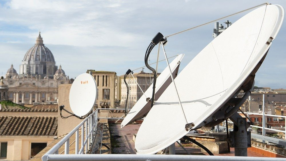 Antenna on the roof of Palazzo Pio, with the Vatican Basilica in the background